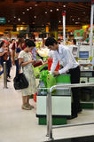 Customer buying food at supermarket Stock Images