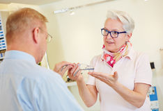 Customer buying glasses at optician Royalty Free Stock Images