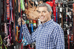 Customer Buying Pet Leash At Store Royalty Free Stock Photography