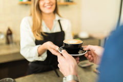 Customer buying some coffee Royalty Free Stock Images