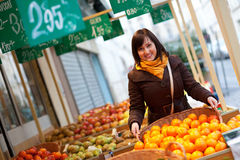 Customer buying tangerines at market Stock Images