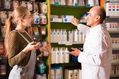 Customer buys medicine Stock Image
