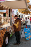 Customer Buys Snack At Food Truck Royalty Free Stock Photo