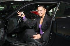 Customer in car dealership with new car Stock Photos