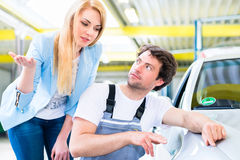 Customer and car painter in auto workshop Stock Photo