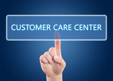Customer Care Center. Hand pressing Customer Care Center button on interface with blue background Stock Photo