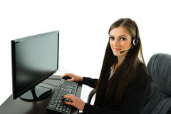 Customer Care Rep on Computer. Customer care representative working at her station Stock Image