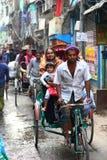 Customer care. Riksjah driver transporting mother and child in Dhaka Bangladesh Royalty Free Stock Photos