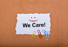 Customer Care sign with smile on paper Royalty Free Stock Images