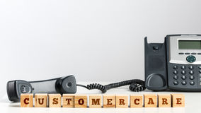 Customer Care on Small Wooden Blocks at the Desk Royalty Free Stock Photo