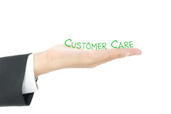 Customer care. Word on hand stock image