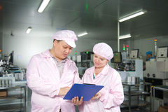 Customer check order in Chinese factory Royalty Free Stock Photo
