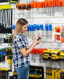 Customer Checking Information Of Screwdriver On Royalty Free Stock Photo