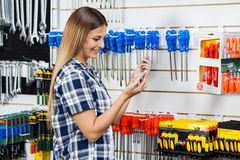 Customer Checking Information Of Screwdriver On Stock Photos
