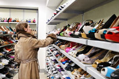 Customer checking shoes Royalty Free Stock Photography