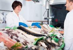 Customer choosing and buying fish Royalty Free Stock Photo