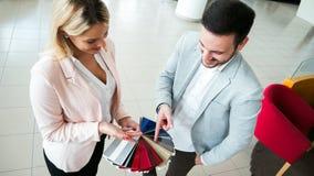 Customer choosing a car color at dealership stock image