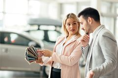 Customer choosing car color stock image
