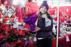 Customer choosing floral decorations for Christmas Royalty Free Stock Images