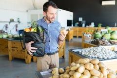 Customer Choosing Fresh Root Vegetables For Healthy Food In Market stock photos