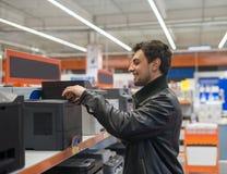 Customer choosing MFP Printer. In supermarket shop Royalty Free Stock Photo