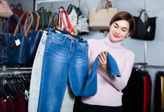 Customer is choosing new jeans Stock Photography