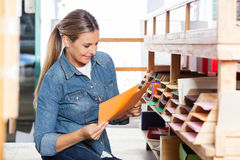 Customer Choosing Papers In Shop Stock Image