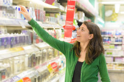 Customer choosing products in supermarket royalty free stock photo