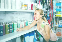 Customer choosing shampoo Stock Photo