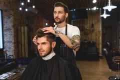 Customer choosing what haircut he wants Royalty Free Stock Photography