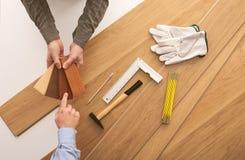 Customer choosing a wooden baseboard Royalty Free Stock Photos