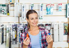 Customer Comparing Screwdrivers In Store Royalty Free Stock Photo