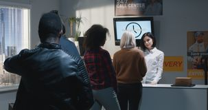 Customer complaining about service in delivery center. Medium shot of an impatient customer standing in queue and complaining about slow service in delivery royalty free stock photo