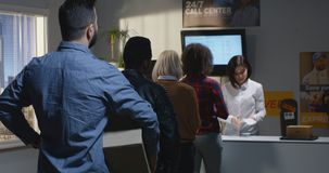 Customer complaining about slow service in delivery center. Medium shot of an impatient customer standing in queue and complaining about slow service in delivery royalty free stock photo