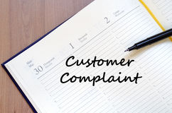Customer complaint write on notebook Royalty Free Stock Photos
