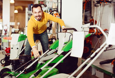 Customer is considering a range of lawnmowers Royalty Free Stock Image