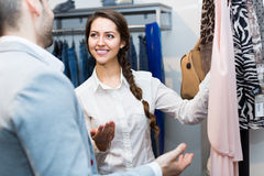 Customer consulting with shop assistant Royalty Free Stock Photography