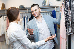 Customer consulting with shop assistant Royalty Free Stock Images