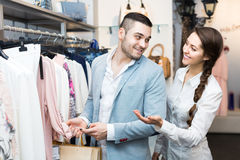 Customer consulting with shop assistant Royalty Free Stock Photo