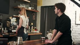 Customer at counter of coffee shop waiting for coffee stock footage