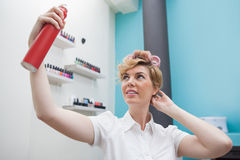 Customer with curlers in hair Stock Photo
