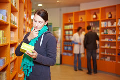 Customer decides in pharmacy Royalty Free Stock Photo