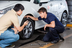 Customer Discussing With Mechanic Repairing Car Royalty Free Stock Photo
