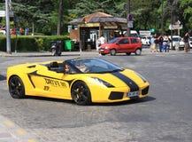 Customer driving a rental Lamborghini Royalty Free Stock Photos