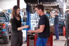 Customer Dropping Off Car at Mechanic Stock Photo