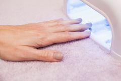Customer drying their painted nails Royalty Free Stock Photos