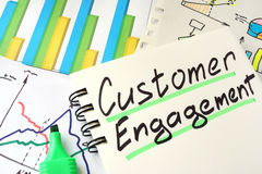 Customer Engagement. Customer Engagement written on a notepad sheet royalty free stock photos