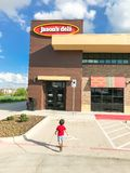 Customer enter Jason Deli restaurant chain in Lewisville, Texas,. LEWISVILLE, TX, US-SEPT 13, 2018:Customer enter Jason Deli, family owned fast casual royalty free stock photography