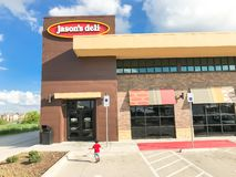 Customer enter Jason Deli restaurant chain in Lewisville, Texas,. LEWISVILLE, TX, US-SEPT 13, 2018:Customer enter Jason Deli, family owned fast casual royalty free stock photos
