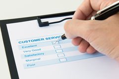 Customer evaluation form. Customer service evaluation form with excellent checkbox ticked Royalty Free Stock Image